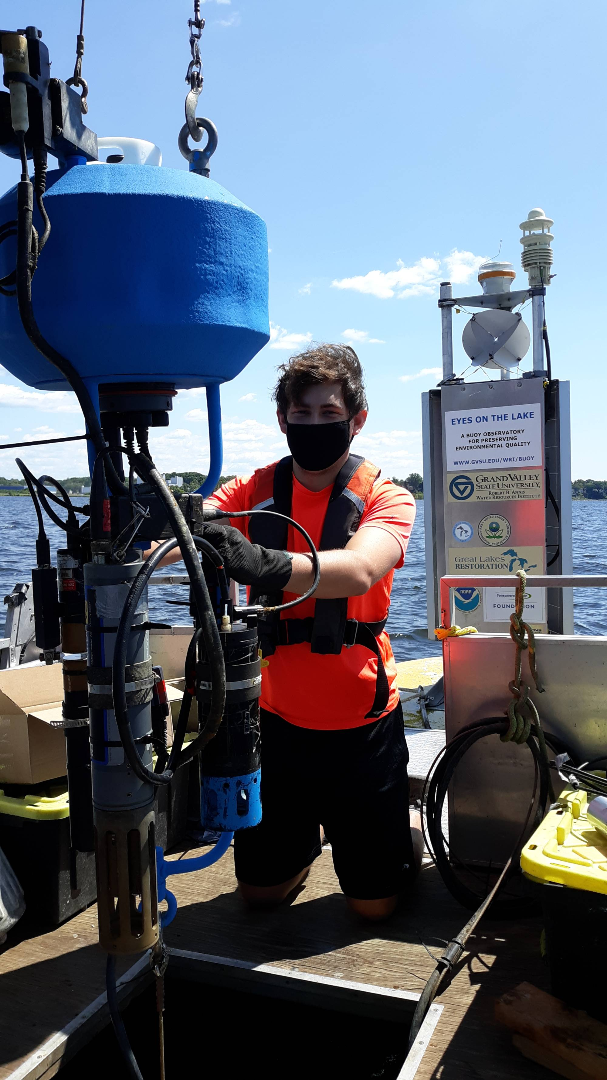 Nate Dugener tends to the buoy's underwater sensors